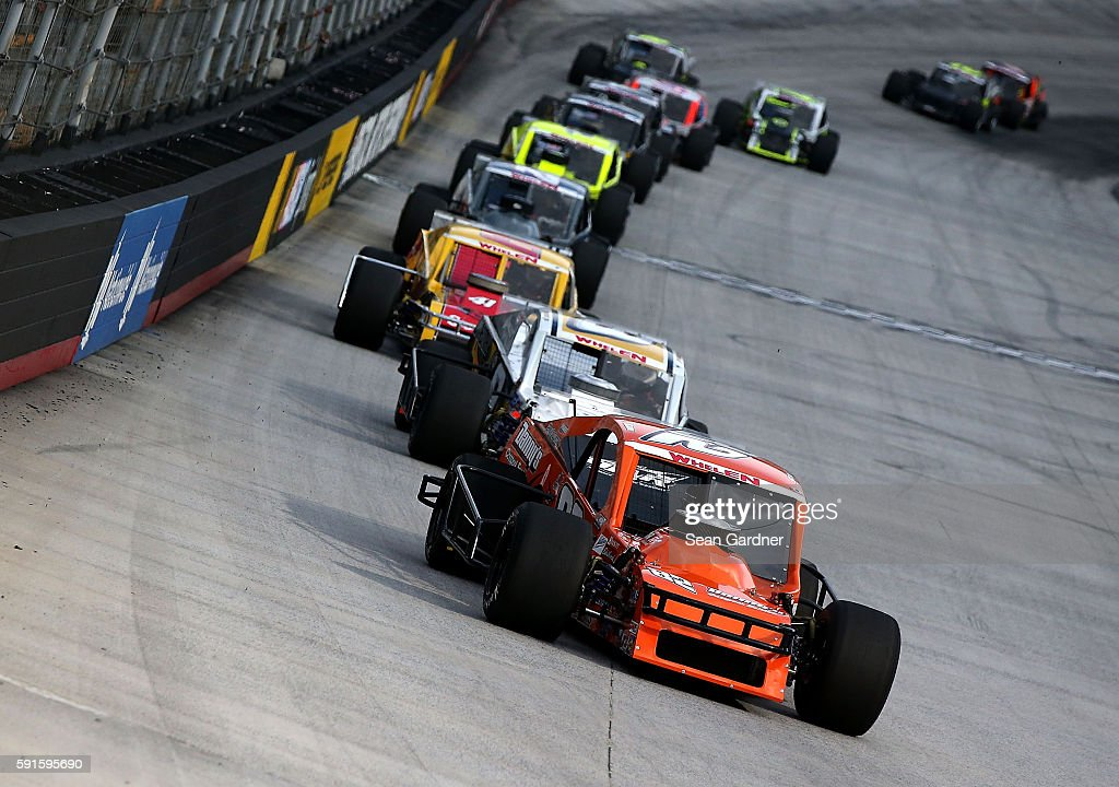 Ron Silk driver of the Horton Avenue Materials Chevrolet leads a group of cars during the NASCAR Whelen Modified Tours Bush's Beans 150 at Bristol...