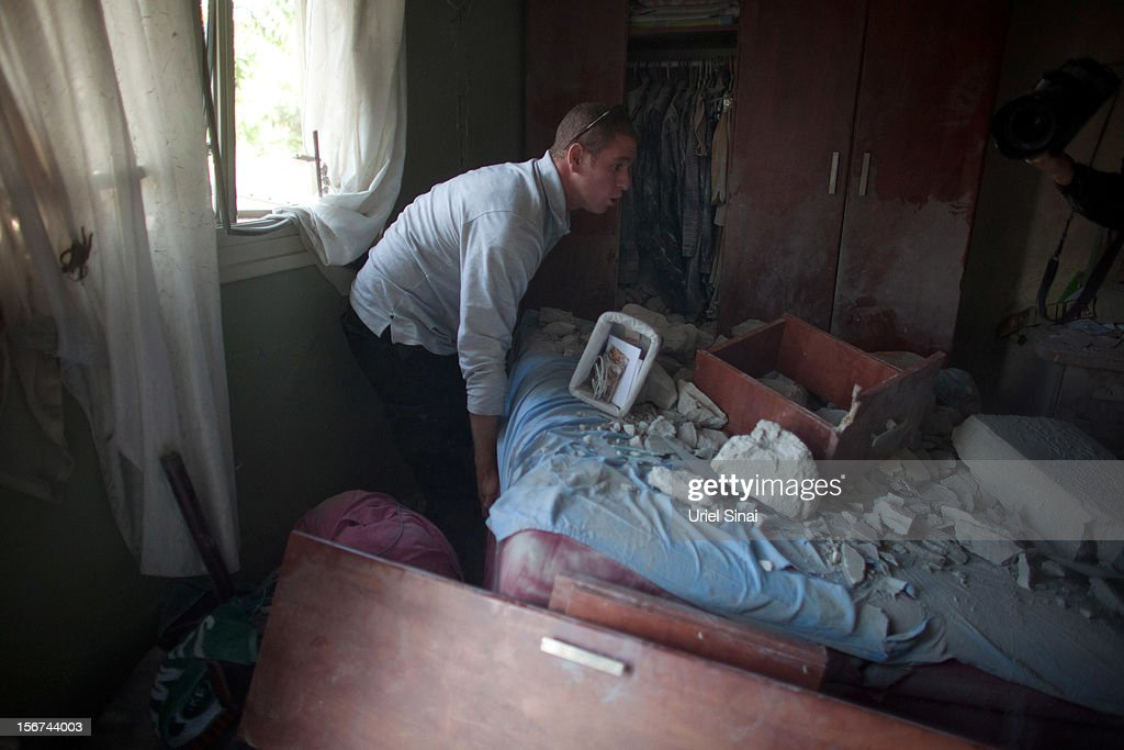 Ron Vachnish looks through his girlfriend Sapir Hachmon's belongings in her room after it was hit by a rocket fired from the Gaza Strip on November 20, 2012 in Beersheba, Israel. Hamas militants and Israel are continuing talks aimed at a ceasefire as the death toll in Gaza reaches over 100 with three Israelis also having been killed by rockets fired by Palestinian militants.