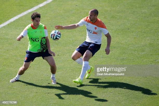 Ron Vlaar and Daryl Janmaat in action during the Netherlands training session at the 2014 FIFA World Cup Brazil held at the Estadio Jose Bastos...