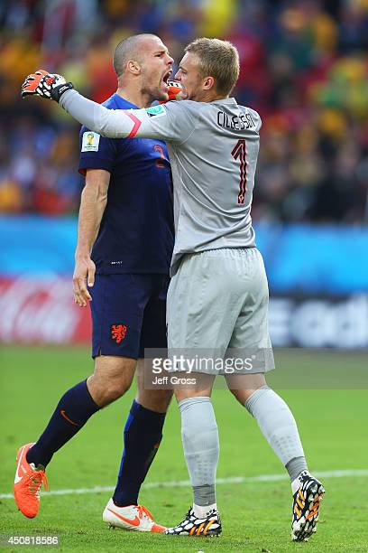 Ron Vlaar and Jasper Cillessen of the Netherlands celebrate after defeating Australia 32 during the 2014 FIFA World Cup Brazil Group B match between...