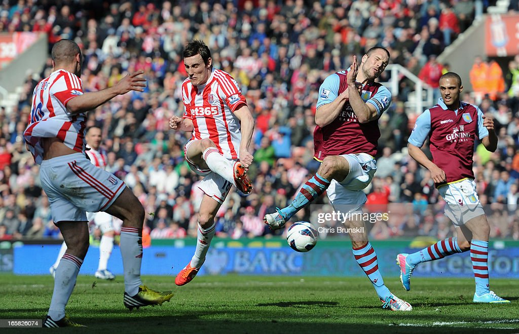 <a gi-track='captionPersonalityLinkClicked' href=/galleries/search?phrase=Ron+Vlaar&family=editorial&specificpeople=605352 ng-click='$event.stopPropagation()'>Ron Vlaar</a> of Aston Villa blocks the attempt on goal of <a gi-track='captionPersonalityLinkClicked' href=/galleries/search?phrase=Dean+Whitehead&family=editorial&specificpeople=185232 ng-click='$event.stopPropagation()'>Dean Whitehead</a> of Stoke City during the Barclays Premier League match between Stoke City and Aston Villa at the Britannia Stadium on April 6, 2013 in Stoke on Trent, England.