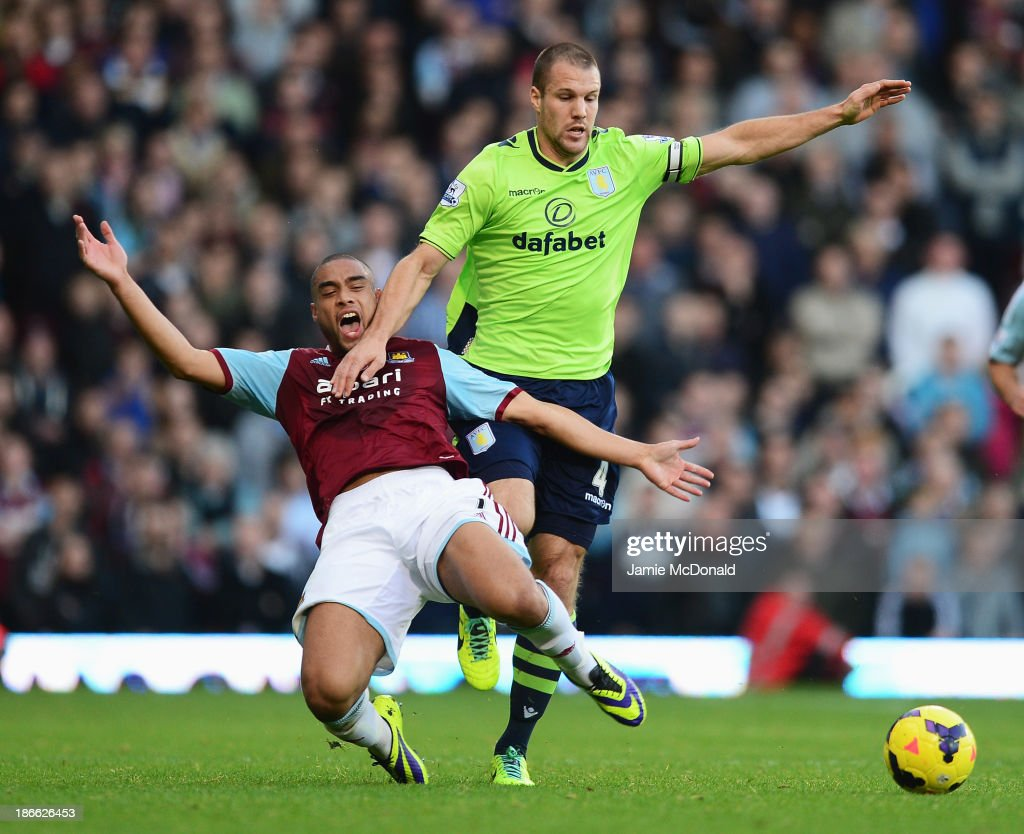 <a gi-track='captionPersonalityLinkClicked' href=/galleries/search?phrase=Ron+Vlaar&family=editorial&specificpeople=605352 ng-click='$event.stopPropagation()'>Ron Vlaar</a> of Aston Villa challenges for the ball with <a gi-track='captionPersonalityLinkClicked' href=/galleries/search?phrase=Winston+Reid&family=editorial&specificpeople=5491819 ng-click='$event.stopPropagation()'>Winston Reid</a> of West Ham United during the Barclays Premier League match between West Ham United and Aston Villa at the Boleyn Ground on November 2, 2013 in London, England.