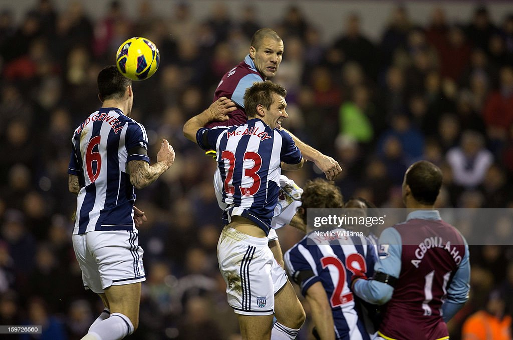 <a gi-track='captionPersonalityLinkClicked' href=/galleries/search?phrase=Ron+Vlaar&family=editorial&specificpeople=605352 ng-click='$event.stopPropagation()'>Ron Vlaar</a> (C) of Aston Villa challenges Gareth McAuley of West Bromwich Albion during the Barclays Premier League match between West Bromwich Albion and Aston Villa at The Hawthorns on January 19, 2013 in West Bromwich, England.