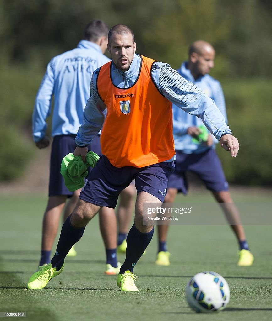 <a gi-track='captionPersonalityLinkClicked' href=/galleries/search?phrase=Ron+Vlaar&family=editorial&specificpeople=605352 ng-click='$event.stopPropagation()'>Ron Vlaar</a> of Aston Villa in action during a Aston Villa training session at the club's training ground at Bodymoor Heath on August 21, 2014 in Birmingham, England.
