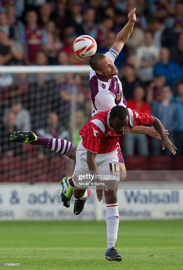 <a gi-track='captionPersonalityLinkClicked' href=/galleries/search?phrase=Ron+Vlaar&family=editorial&specificpeople=605352 ng-click='$event.stopPropagation()'>Ron Vlaar</a> of Aston Villa is challenged by Craig Westcarr of Walsall during the Pre Season Friendly match between Walsall and Aston Villa at Banks' Stadium on July 31, 2013 in Walsall, England.