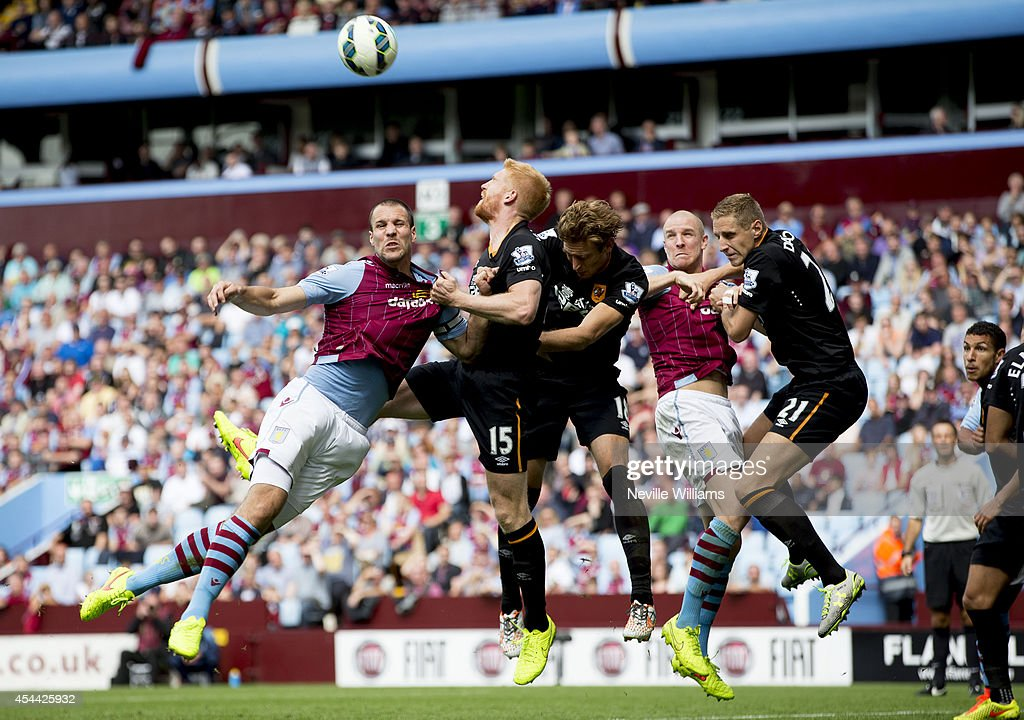 <a gi-track='captionPersonalityLinkClicked' href=/galleries/search?phrase=Ron+Vlaar&family=editorial&specificpeople=605352 ng-click='$event.stopPropagation()'>Ron Vlaar</a> of Aston Villa is challenged by Paul McShane of Hull City during the Barclays Premier League match between Aston Villa and Hull City at Villa Park on August 31, 2014 in Birmingham, England.
