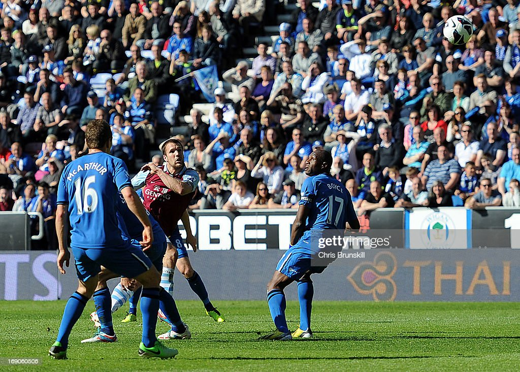 <a gi-track='captionPersonalityLinkClicked' href=/galleries/search?phrase=Ron+Vlaar&family=editorial&specificpeople=605352 ng-click='$event.stopPropagation()'>Ron Vlaar</a> of Aston Villa scores his side's second goal during the Barclays Premier League match between Wigan Athletic and Aston Villa at DW Stadium on May 19, 2013 in Wigan, England.