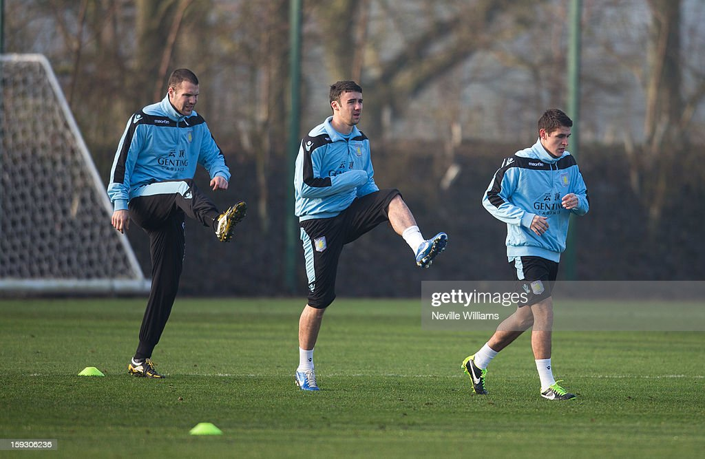 <a gi-track='captionPersonalityLinkClicked' href=/galleries/search?phrase=Ron+Vlaar&family=editorial&specificpeople=605352 ng-click='$event.stopPropagation()'>Ron Vlaar</a> of Aston Villa trains with team mates Enda Stevens and Ashley Westwood during a Aston Villa training session at the club's training ground at Bodymoor Heath on January 11, 2013 in Birmingham, England.