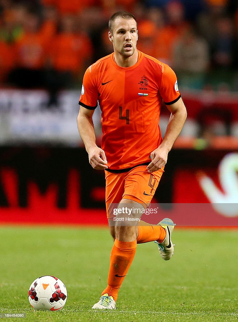 <a gi-track='captionPersonalityLinkClicked' href=/galleries/search?phrase=Ron+Vlaar&family=editorial&specificpeople=605352 ng-click='$event.stopPropagation()'>Ron Vlaar</a> of Holland during the FIFA 2014 World Cup Qualifing match between Holland and Hungary at Amsterdam Arena on October 11, 2013 in Amsterdam, Netherlands.