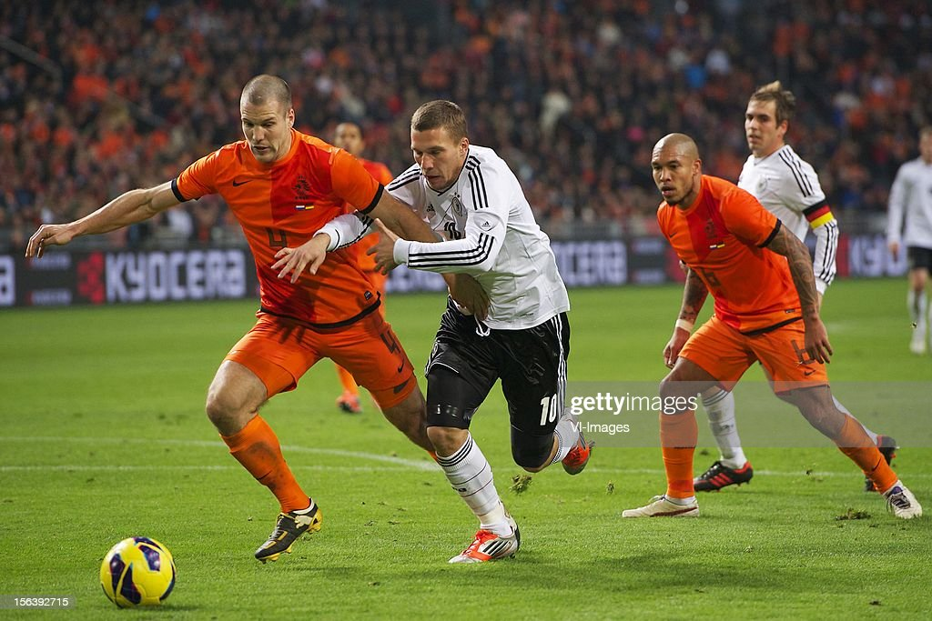 Ron Vlaar of Holland, Lukas Podolski of Germany during the Friendly match between Holland and Germany at the Amsterdam Arena on November 14, 2012 in Amsterdam, The Netherlands.