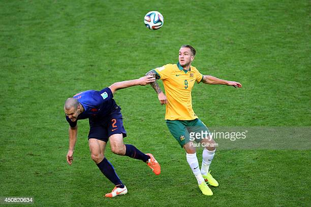 Ron Vlaar of the Netherlands and Adam Taggart of Australia compete for the ball during the 2014 FIFA World Cup Brazil Group B match between Australia...