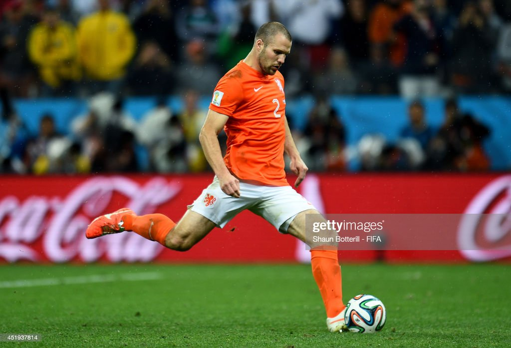 <a gi-track='captionPersonalityLinkClicked' href=/galleries/search?phrase=Ron+Vlaar&family=editorial&specificpeople=605352 ng-click='$event.stopPropagation()'>Ron Vlaar</a> of the Netherlands takes his penalty shot in the penalty shootout during the 2014 FIFA World Cup Brazil Semi Final match between Netherlands and Argentina at Arena de Sao Paulo on July 9, 2014 in Sao Paulo, Brazil.