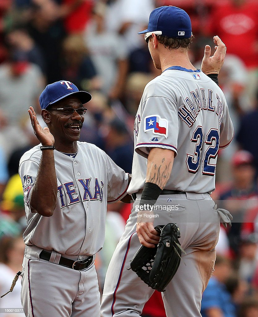 <a gi-track='captionPersonalityLinkClicked' href=/galleries/search?phrase=Ron+Washington&family=editorial&specificpeople=225012 ng-click='$event.stopPropagation()'>Ron Washington</a> #38 of the Texas Rangers celebrates with Josh Hamilton #32 after defeating the Boston Red Sox, 10-9, at Fenway Park August 8, 2012 in Boston, Massachusetts.