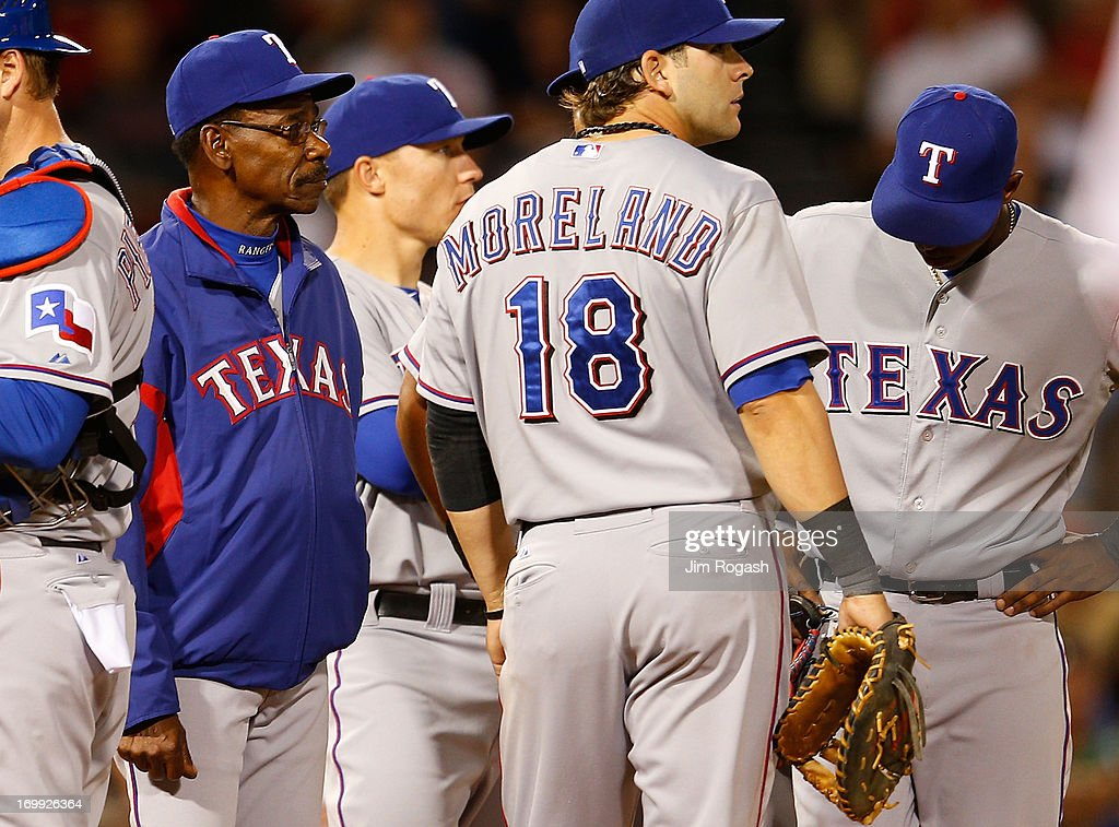 <a gi-track='captionPersonalityLinkClicked' href=/galleries/search?phrase=Ron+Washington&family=editorial&specificpeople=225012 ng-click='$event.stopPropagation()'>Ron Washington</a> #38 of the Texas Rangers comes onto the field to remover pitcher Joe Ortiz #58 of the Texas Rangers in the 6th inning against the Boston Red Sox at Fenway Park on June 4, 2013 in Boston, Massachusetts.
