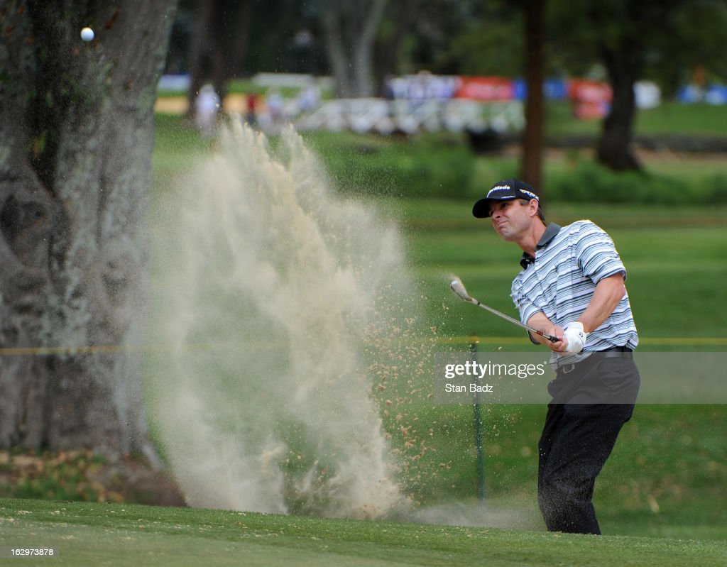 Ron Whittaker hits from a bunker on the tenth hole during the third round of the Colombia Championship at Country Club de Bogota on March 2, 2013 in Bogota, Colombia.
