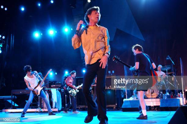 Ron Wood Mick Jagger Charlie Watts and Keith Richards of The Rolling Stones perform with Angus Young and Malcolm Young of AC/DC