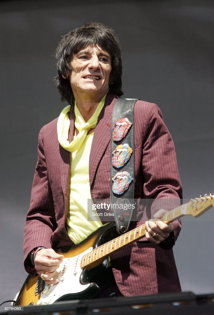 Ron Wood of The Rolling Stones performs onstage during a press conference to announce a world tour at the Julliard Music School May 10, 2005 in New York City.