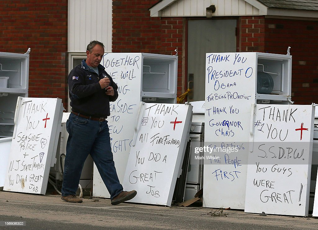 Ron Youmans walks away after writing thank you notes on refrigerators damaged by Superstorm Sandy on November 25, 2012 in Seaside Heights, New Jersey. New Jersey Gov. Christie estimated that Superstorm Sandy cost New Jersey $29.4 billion in damage and economic losses.