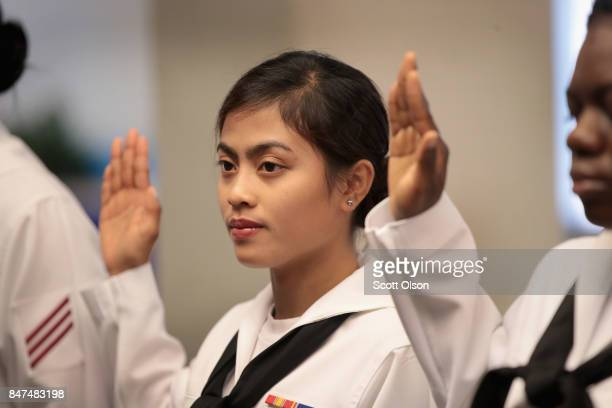 Rona Cortez who was born in the Philippines and is currently serving in the US Navy takes the Oath of Allegiance to become a US Citizen alongside...
