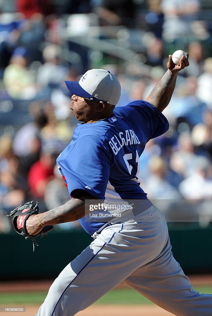 Ronald Belisario #51 of the Los Angeles Dodgers pitches against the Chicago Cubs on February 27, 2013 at HoHoKam Park in Mesa, Arizona.
