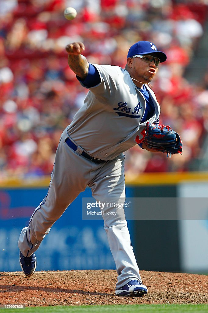 Ronald Belisario #54 of the Los Angeles Dodgers pitches in relief in the eighth inning against the Cincinnati Reds at Great American Ball Park on September 7, 2013 in Cincinnati, Ohio. Cincinnati defeated Los Angeles 4-3.