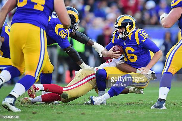 Ronald Blair of the San Francisco 49ers sacks Jared Goff of the Los Angeles Rams during the fourth quarter at Los Angeles Memorial Coliseum on...