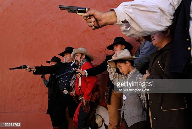 Ronald Cruz center adjusts his hat as he and others with the Shadow Riders pose for a photograph during Wyatt Earp Days on Saturday May 26 2012 in...