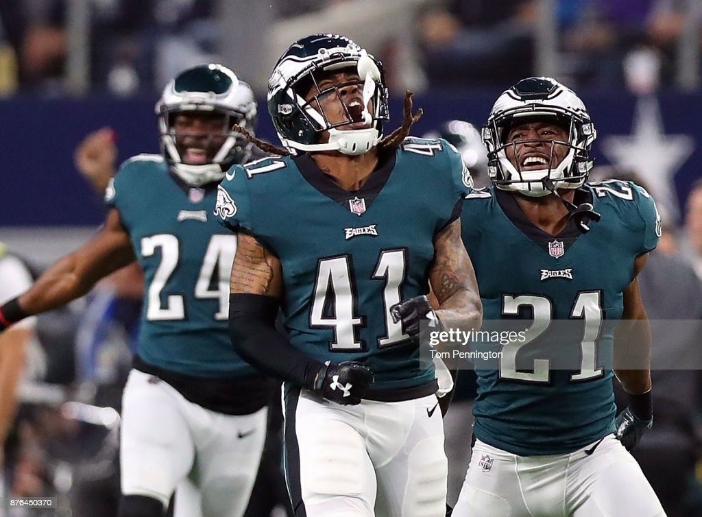 Ronald Darby #41 of the Philadelphia Eagles celebrates his second quarter interception agaisnt the Dallas Cowboys with Corey Graham #24 of the Philadelphia Eagles and Patrick Robinson #21 of the Philadelphia Eagles at AT&T Stadium on November 19, 2017 in Arlington, Texas.