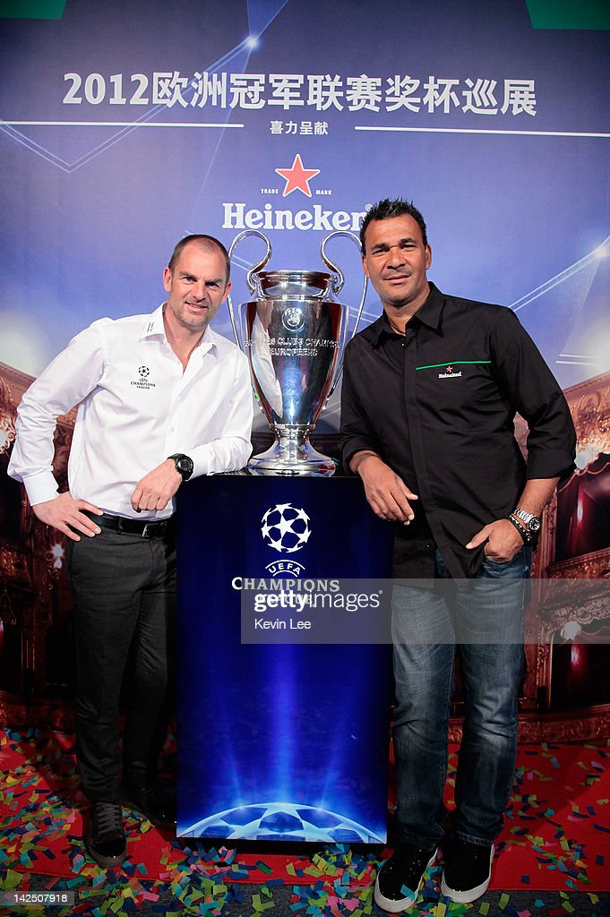 Ronald de Boer and (R) <a gi-track='captionPersonalityLinkClicked' href=/galleries/search?phrase=Ruud+Gullit&family=editorial&specificpeople=2104975 ng-click='$event.stopPropagation()'>Ruud Gullit</a> pose during the UEFA Champions League Trophy 2012 tour on April 6, 2012 in Shanghai, China.