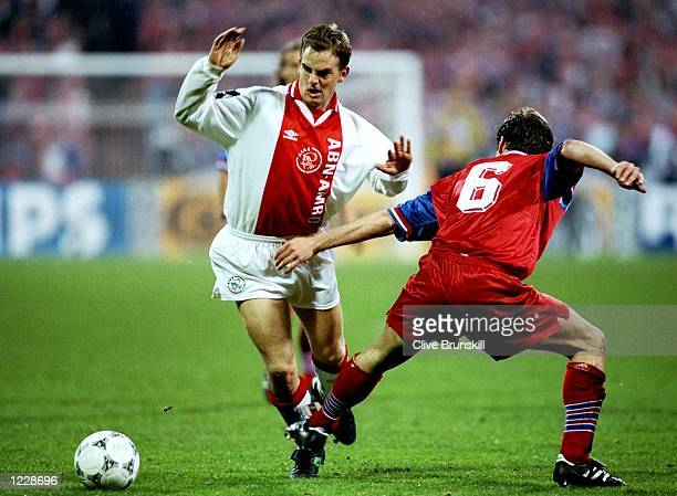 Ronald de Boer of Ajax is fouled by Christian Naulinger of Bayern Munich during the European Cup semifinal at the Olympic Stadium in Munich Germany...