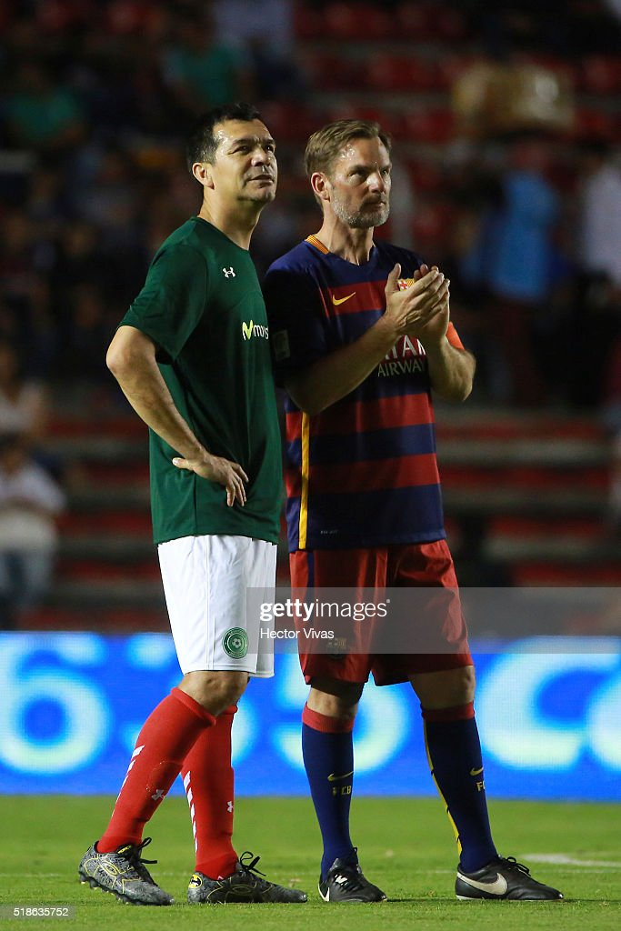 Ronald de Boer of Barcelona Legends (R) and Jared Borguetti of Leyendas de Mexico look on during a tribute to Johan Cruyff during the match between Leyendas de Mexico and FCB Legends at La Corregidora Stadium on april 01, 2016 in Queretaro, Mexico.