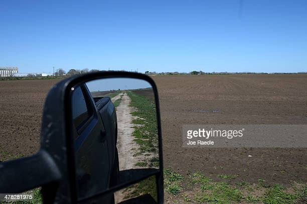 Ronald Gertson a fourth generation rice farmer drives his pickup past rice fields that may not be planted this year due to a severe water shortage on...