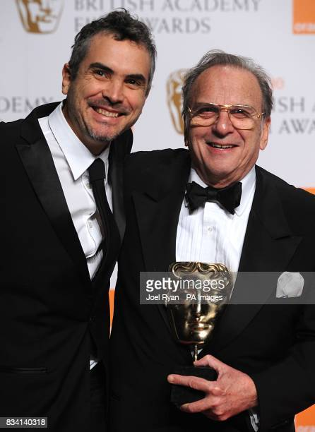 Ronald Harwood with the award for Best Adapted Screenplay recieved for The Diving Bell And The Butterfly with presenter Alfonso Cuaron during the...