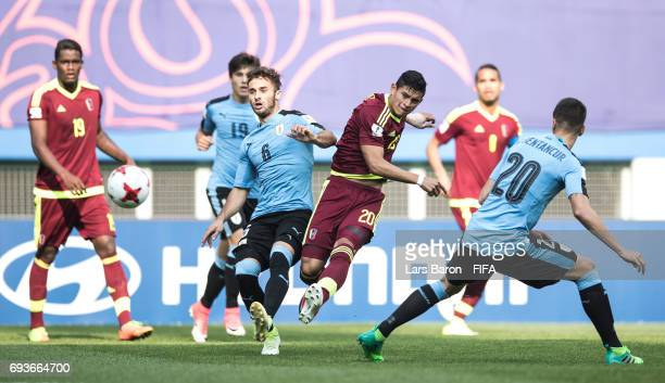 Ronald Hernandez of Venezuela shoots on goal next to Marcelo Saracchi of Uruguay during the FIFA U20 World Cup Korea Republic 2017 Semi Final match...