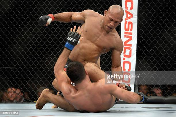 Ronald 'Jacare' Souza punches Gegard Mousasi in their middleweight fight during the UFC Fight Night event inside the Grand Theatre at Foxwoods Resort...