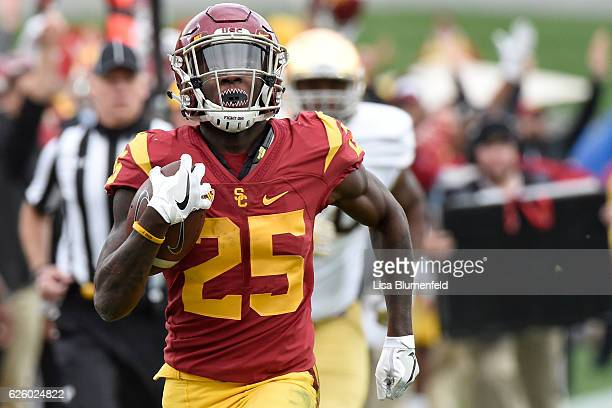 Ronald Jones II of the USC Trojans carries the ball to score a touchdown in the first quarter against the Notre Dame Fighting Irish at Los Angeles...