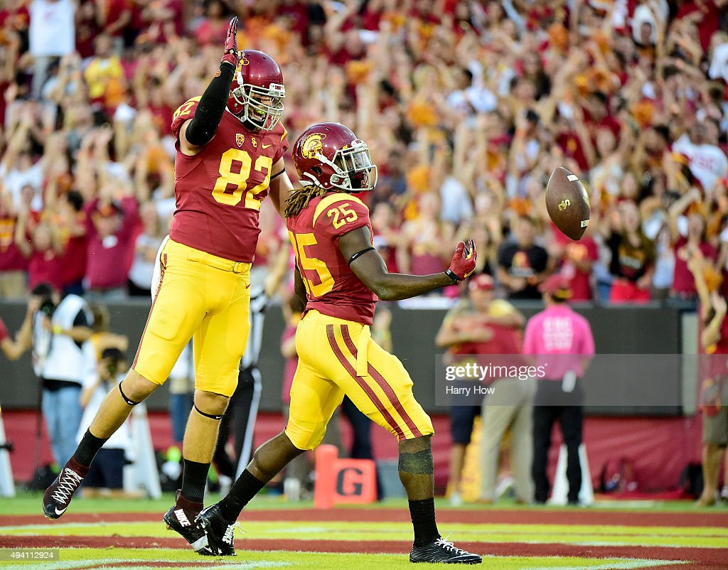 Ronald Jones II #25 of the USC Trojans celebrates his touchdown with Tyler Petite #82 to take a 21-14 lead over the Utah Utes at Los Angeles Memorial Coliseum on October 24, 2015 in Los Angeles, California.