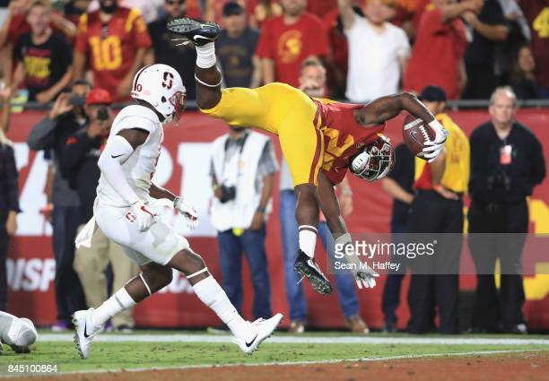 Ronald Jones II of the USC Trojans flips into the end zone to score a fourth quarter touchdown against the Stanford Cardinal at Los Angeles Memorial...