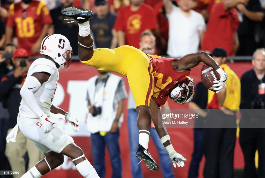Ronald Jones II #25 of the USC Trojans flips into the end zone to score a fourth quarter touchdown against the Stanford Cardinal at Los Angeles Memorial Coliseum on September 9, 2017 in Los Angeles, California.