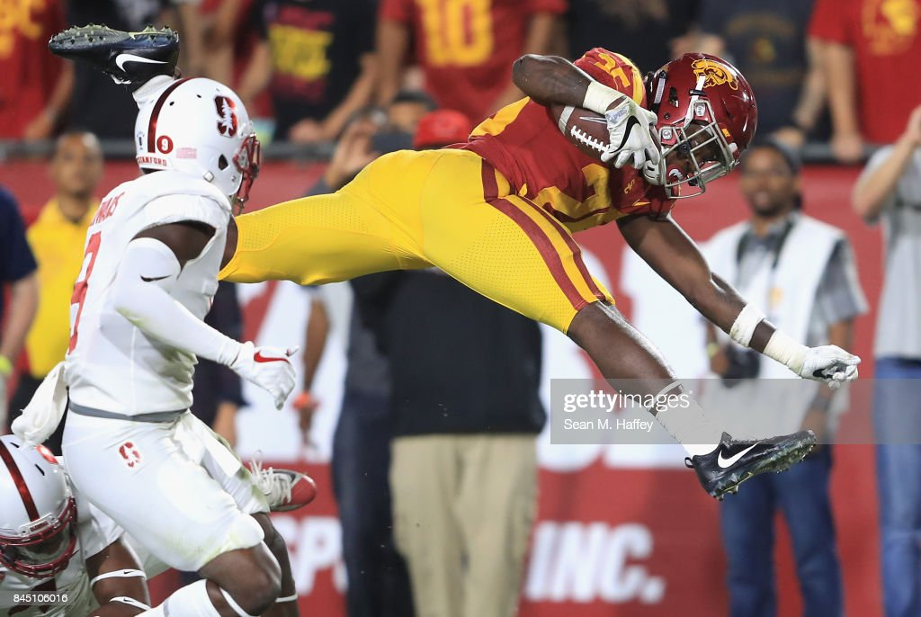 Ronald Jones II #25 of the USC Trojans jumps into the end zone to score a fourth quarter touchdown against the Stanford Cardinal at Los Angeles Memorial Coliseum on September 9, 2017 in Los Angeles, California.