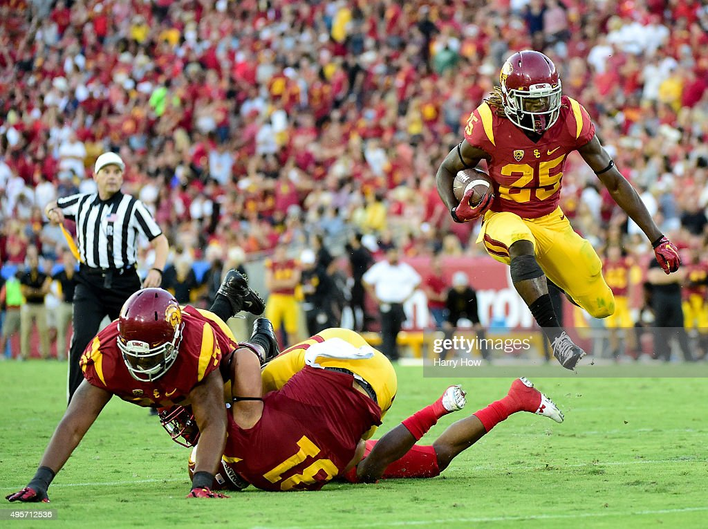 Ronald Jones II #25 of the USC Trojans jumps over a block during the game against the Utah Utes at Los Angeles Memorial Coliseum on October 24, 2015 in Los Angeles, California.