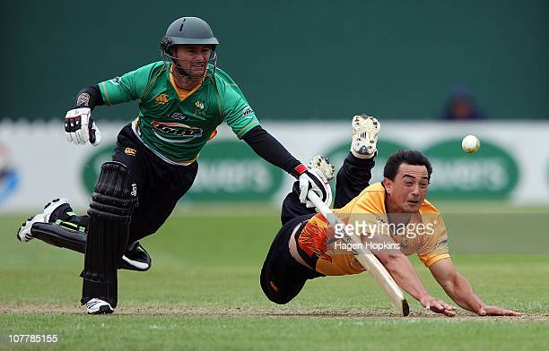 Ronald Karatiana of the Firebirds fields the ball off his own bowling while Kruger van Wyk of the Stags attempts to make his ground during the HRV...