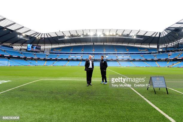 Ronald Koeman inspects the pitch before the Premier League match between Manchester City and Everton at Etihad Stadium on August 21 2017 in...