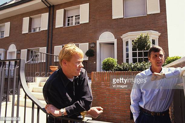 Ronald Koeman Johan Cruijff pose together in front of their houses in Barcelona where they were neighbours at April 11 1991 at Barcelona Spain