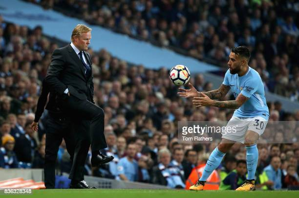 Ronald Koeman Manager of Everton and Nicolas Otamendi of Manchester City in action during the Premier League match between Manchester City and...