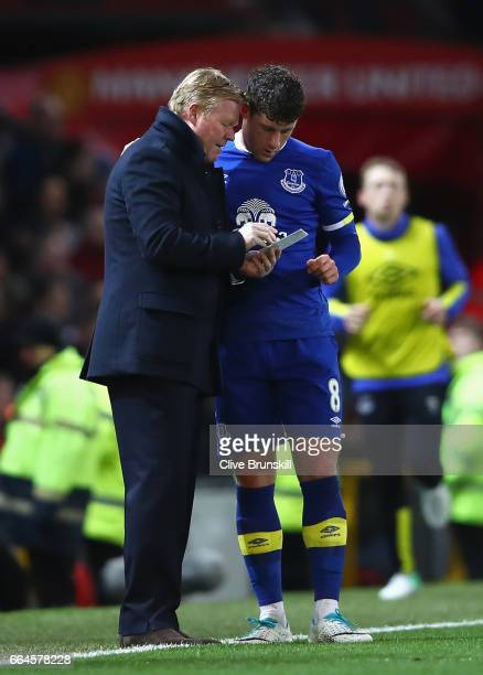 Ronald Koeman Manager of Everton speaks to Ross Barkley of Everton during the Premier League match between Manchester United and Everton at Old...