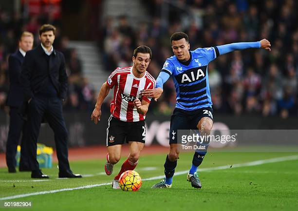 Ronald Koeman manager of Southampton and Mauricio Pochettino manager of Tottenham Hotspur watch Cedric Soares of Southampton and Dele Alli of...