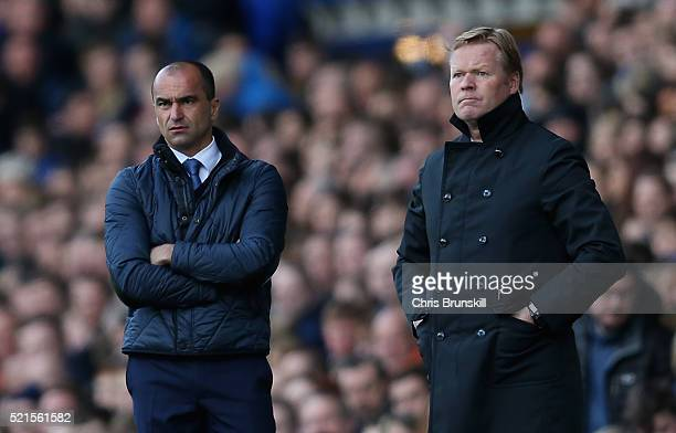 Ronald Koeman manager of Southampton and Roberto Martinez manager of Everton look on during the Barclays Premier League match between Everton and...