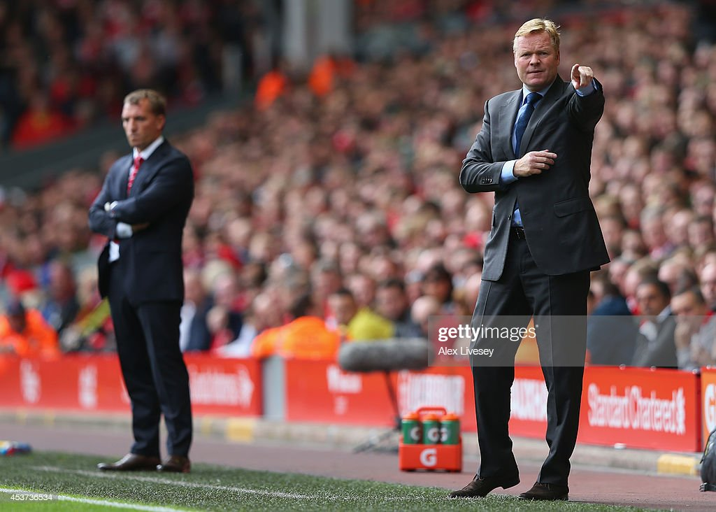 <a gi-track='captionPersonalityLinkClicked' href=/galleries/search?phrase=Ronald+Koeman&family=editorial&specificpeople=652522 ng-click='$event.stopPropagation()'>Ronald Koeman</a>, manager of Southampton gives instructions with <a gi-track='captionPersonalityLinkClicked' href=/galleries/search?phrase=Brendan+Rodgers+-+Soccer+Manager&family=editorial&specificpeople=5446684 ng-click='$event.stopPropagation()'>Brendan Rodgers</a>, manager of Liverpool during the Barclays Premier League match between Liverpool and Southampton at Anfield on August 17, 2014 in Liverpool, England.