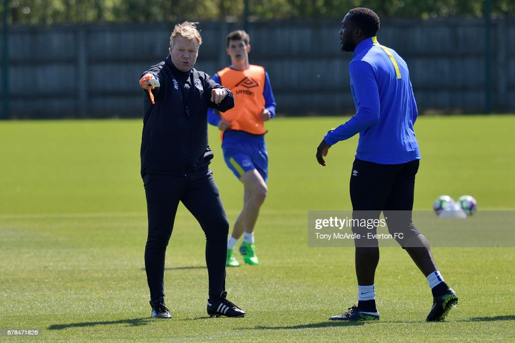 Ronald Koeman speaks to Romelu Lukaku during the Everton FC training session at USM Finch Farm on May 4, 2017 in Halewood, England.